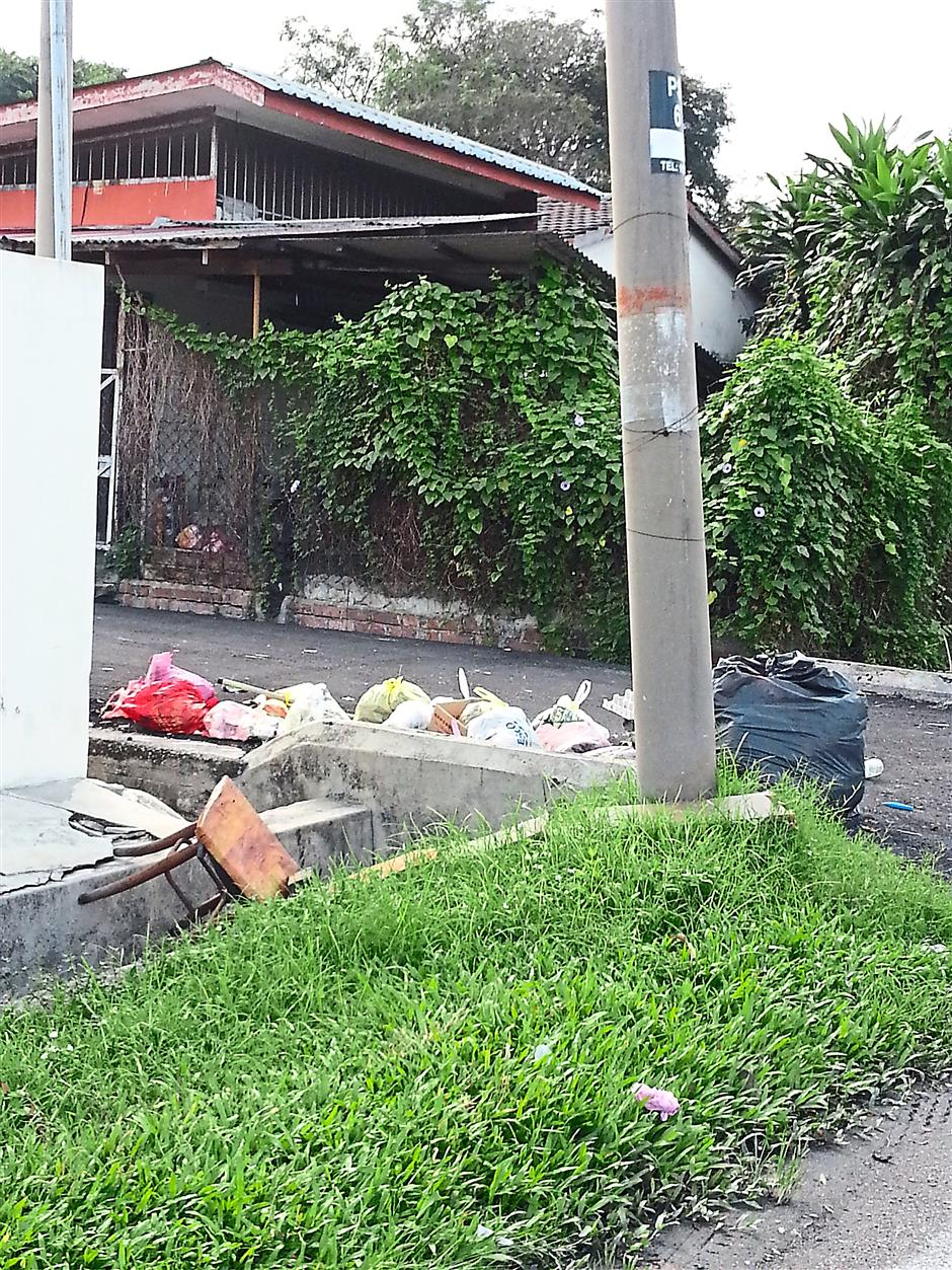 What a mess: This backlane in Taman Shatin, Ipoh is yet another dumpsite for residents.