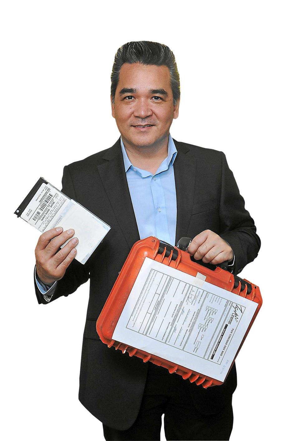 Digital package: CEO of TGV Cinemas Sdn Bhd Gerald V Dibbayawan holding a DCP, the encrypted hard disk which now stores movies ready for distribution