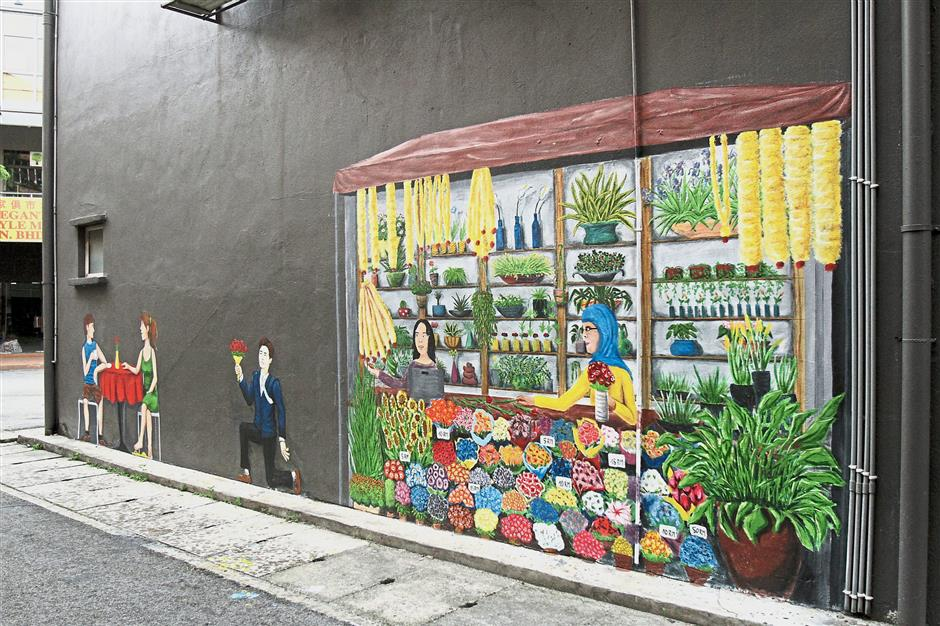 Turello says he incorporates elements of Malaysian culture into the murals.