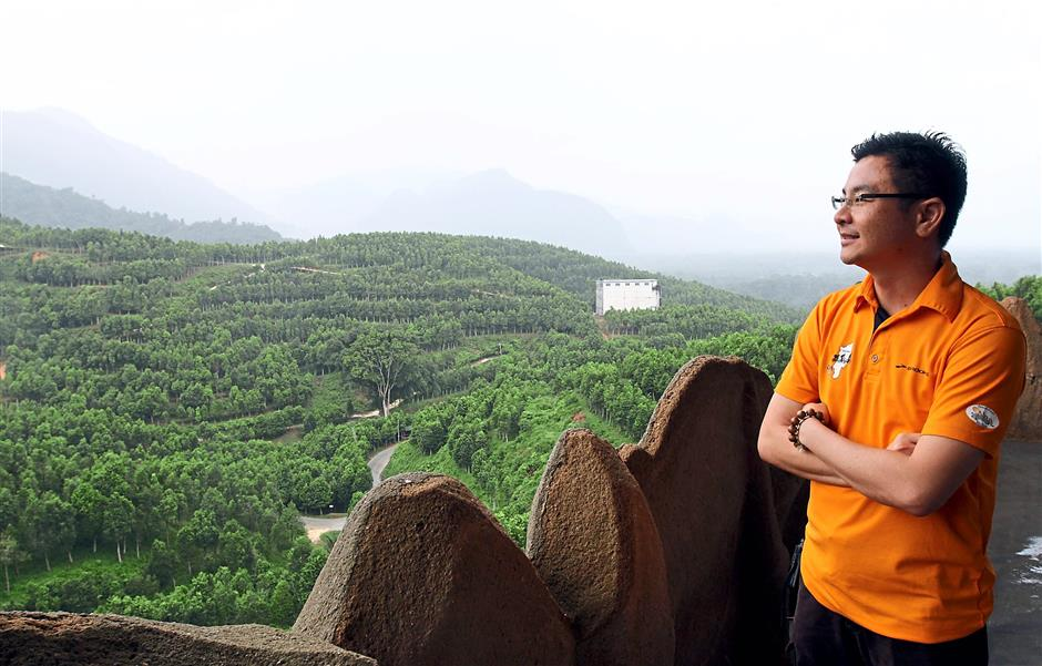 Gaharu Tea Valley Gopeng chief executive officer Nicklaus admiring the view of over 200,000 gaharu trees growing in the plantation located in Gopeng. — Photos: RONNIE CHIN