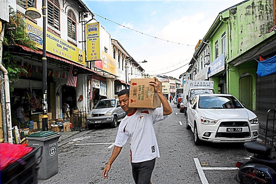 Seremban's Singapore Street in still one of the more popular areas for shoppers as they are able to bargain and get goods at cheaper rates. UU BAN/The Star