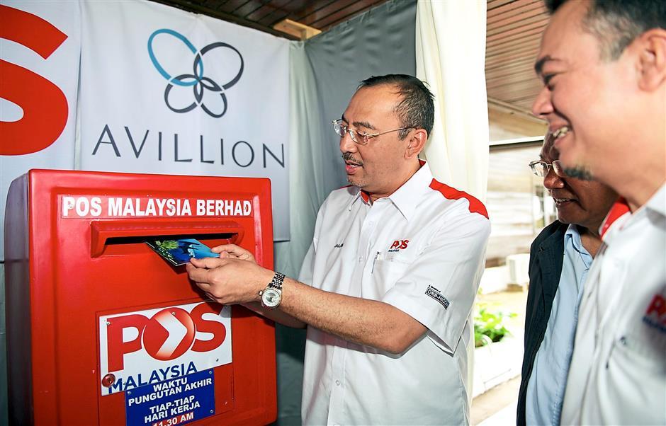 1 Jailani Johari posting a postcard at the Layang-Layang post office. 2. The deep sea post box.