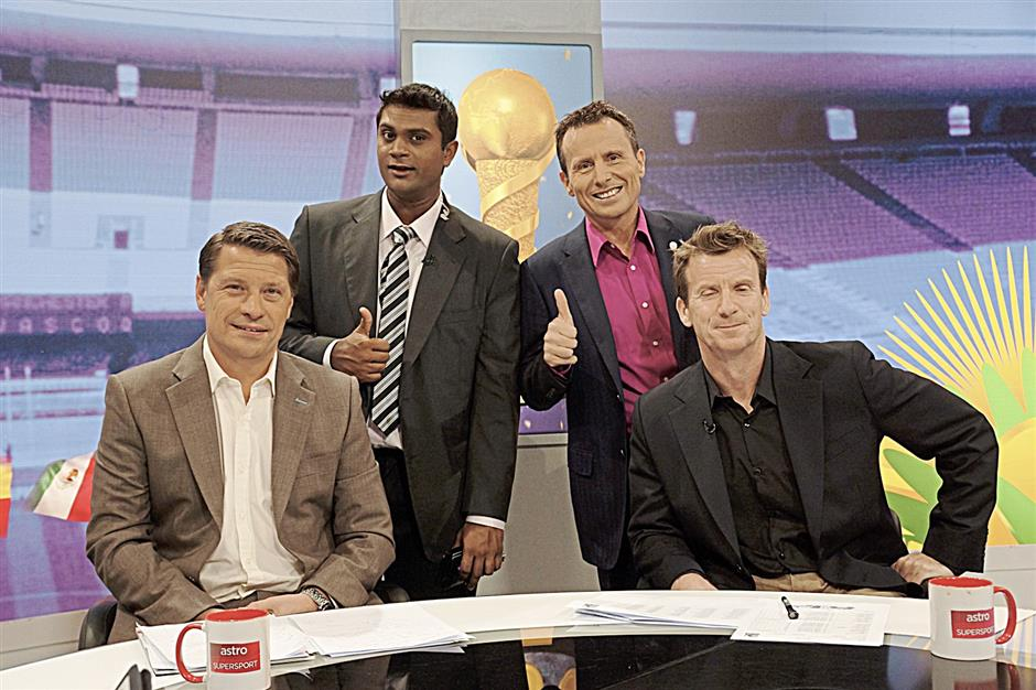 Tierney working on the 2013 Confederations Cup with Tony Cottee (left), the columnist and Burn from Astro Arena.