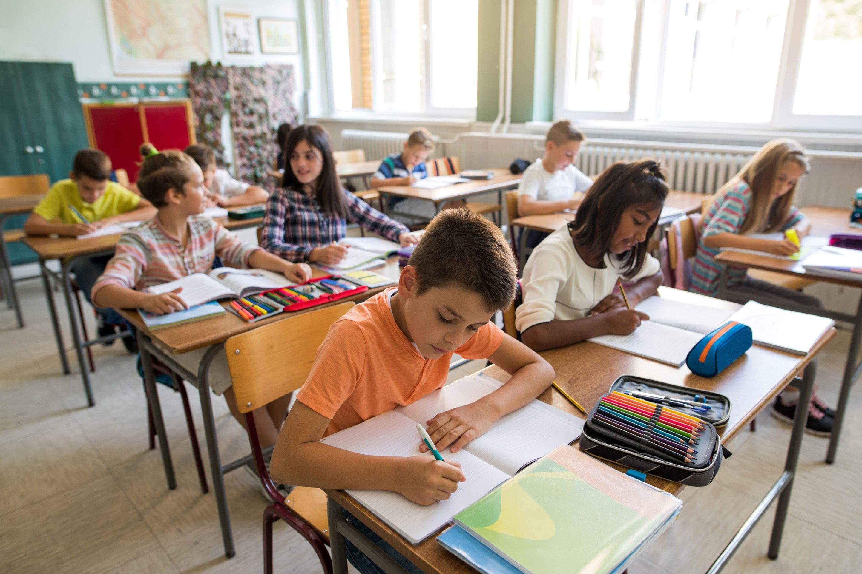 Schools all over the world have struggled to adapt to the rise of pocket-sized devices as parents grow increasingly anxious about the amount of time their children spend glued to the screen. u00a9 skynesher / IStock.com