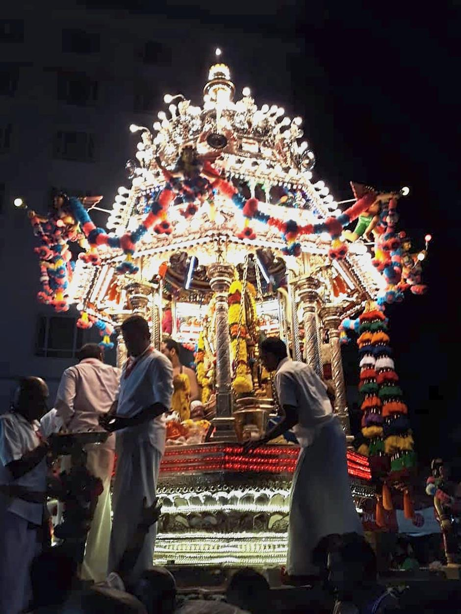 Religious procession: The silver chariot making its way home to Kovil Veedu in Penang Street.