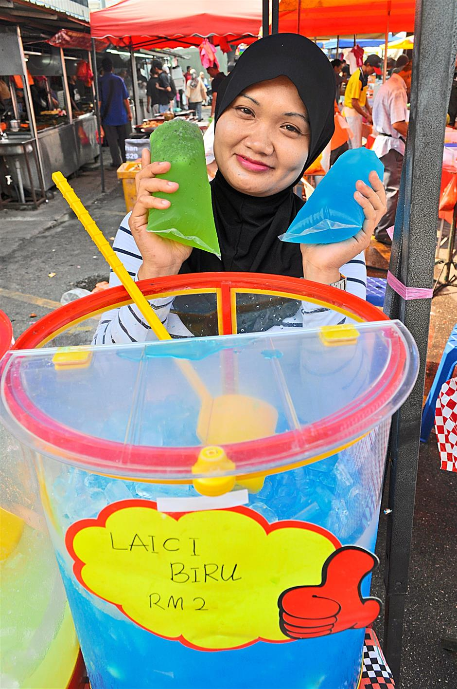Catering to the thirsty. On normal days a drink vendor may earn only RM500 a day