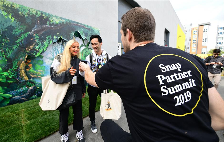 A cellphone is returned after pictures are taken at the first annual Snap Partner Summit in West Hollywood, California on April 4, 2019. - Messaging app Snapchat, which is widely popular among younger users but has struggled to turn a profit since its creation in 2011, on Thursday unveiled new features including an integrated gaming platform, an expansion of its original series and new partnerships with developers. (Photo by Frederic J. BROWN / AFP)