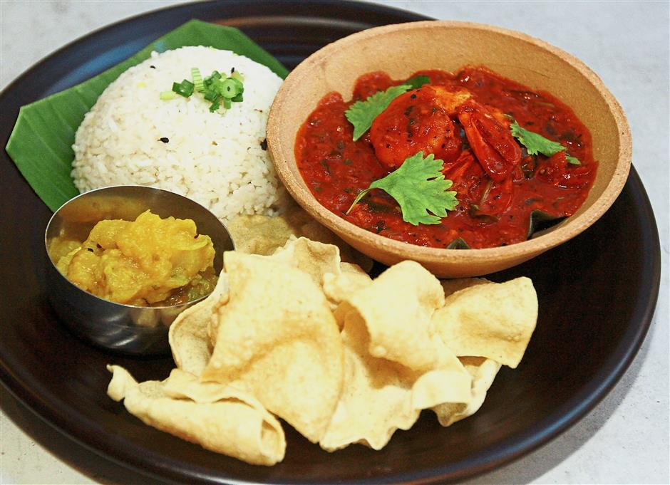 Kerala Prawn Sambal is a spicy dish, though heat levels can be adjusted upon request.