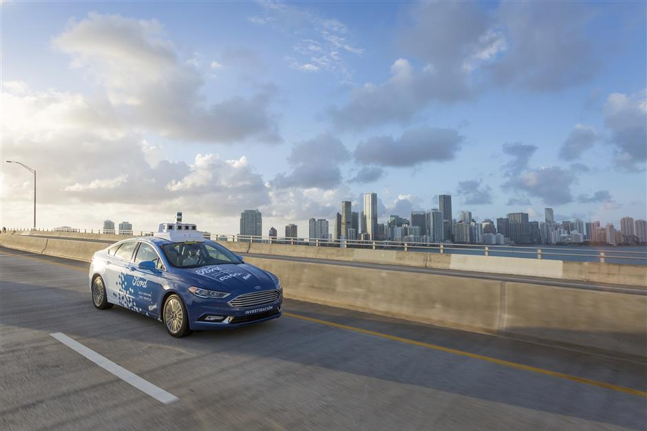 This undated image provided by Ford Motor Co. shows a self-driving vehicle from Ford and Ford partner Argo Al in Miami, Fla. Ford is making Miami-Dade County its new test bed for self-driving vehicles. Argo AI already has a fleet of cars in the area making the highly detailed maps that are necessary for self-driving. Ford also will establish its first-ever autonomous vehicle terminal in Miami, where it will learn how to service and deploy its test fleet. (Ford Motor Co. via AP)