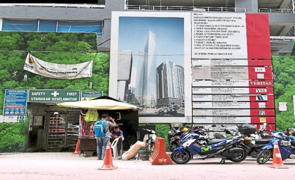 Billboards on hoardings on private properties such as this in Jalan Yap Tai Chi also need a licence from DBKL.