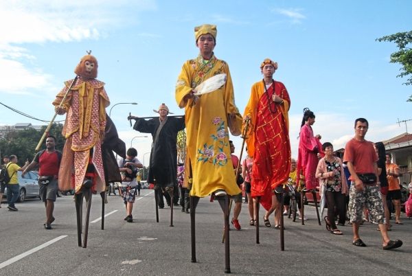 Stilt-walkers dressed up as Chinese mythological characters from the classic 'Journey to the West' story.