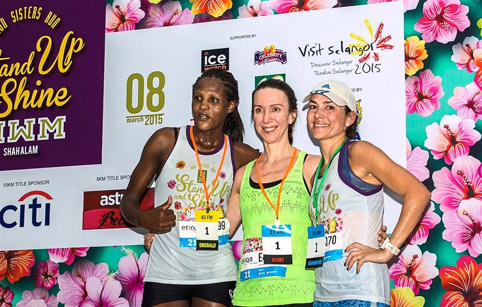One for the album: (From left) MWM Etiqa half-marathon Emerald category winner Cynthia Chelangat Towett, Ruby category champ Joanna Louise Dent and Diamond category winner Hayley on the podium.