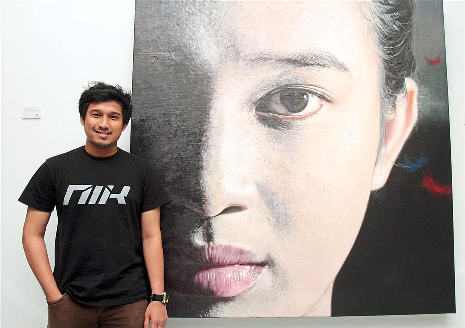 Portrait: Big brother Nik Mohd Hazri with his painting called 'Still Remember'.