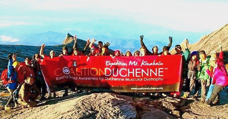 Past climbers of Coalition Duchenne with their banner on top of Mount Kinabalu. u2014 filepic