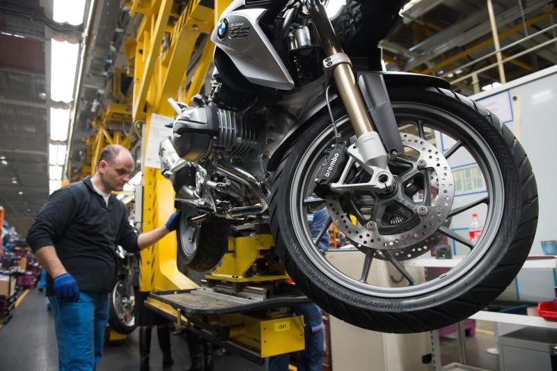 File photo of a motorcycle assembly line at the BMW motorcycle factory in Berlin. German industrial output rose a disappointing 0.3% on the month in June - EPA Photo.