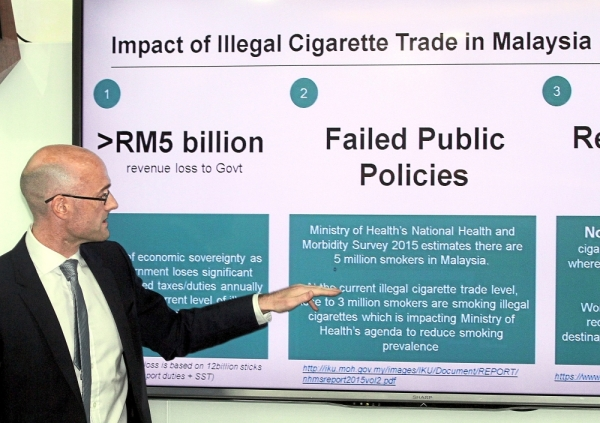 General Manager of JTI International Berhad  Cormac O' Rourke,  briefs on illegal cigarette trade by Japan Tobacco International Malaysia.The study was conducted by Nielsen and commissioned by the Confederation of Malaysian Tobacco Manufacturers.