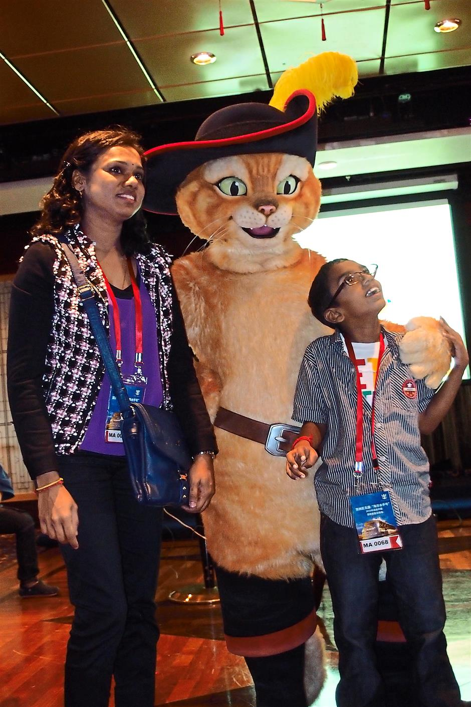 Sumathi (left) and her son taking a picture with the Puss In Boot character.