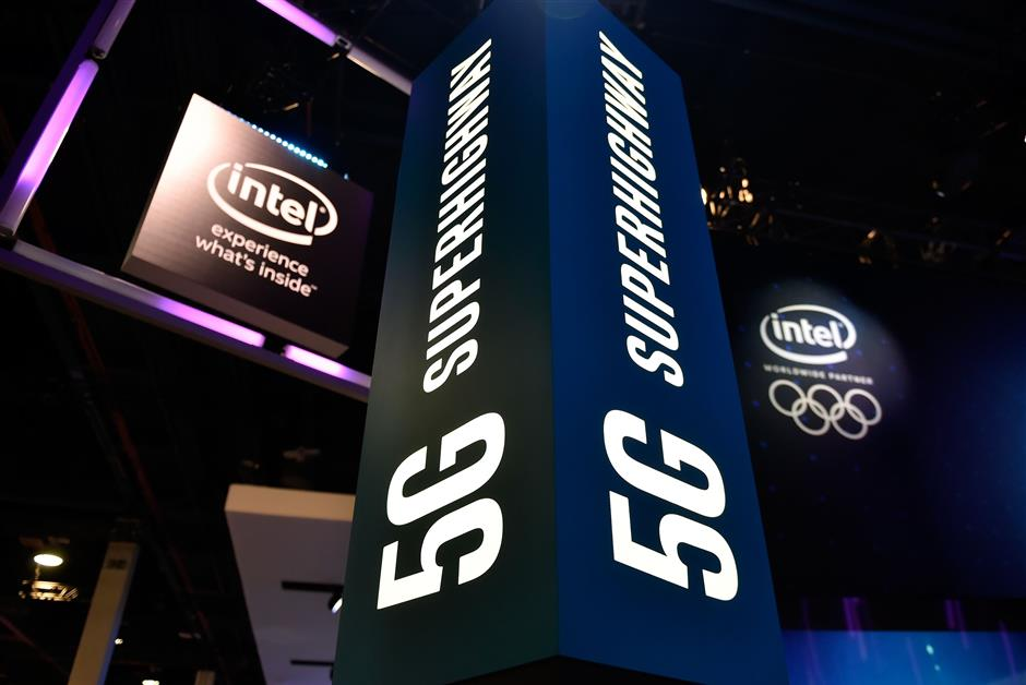 LAS VEGAS, NV - JANUARY 09: Signage for 5G technology is displayed at the Intel booth during CES 2018 at the Las Vegas Convention Center on January 9, 2018 in Las Vegas, Nevada. CES, the world\'s largest annual consumer technology trade show, runs through January 12 and features about 3,900 exhibitors showing off their latest products and services to more than 170,000 attendees.   David Becker/Getty Images/AFP == FOR NEWSPAPERS, INTERNET, TELCOS & TELEVISION USE ONLY ==