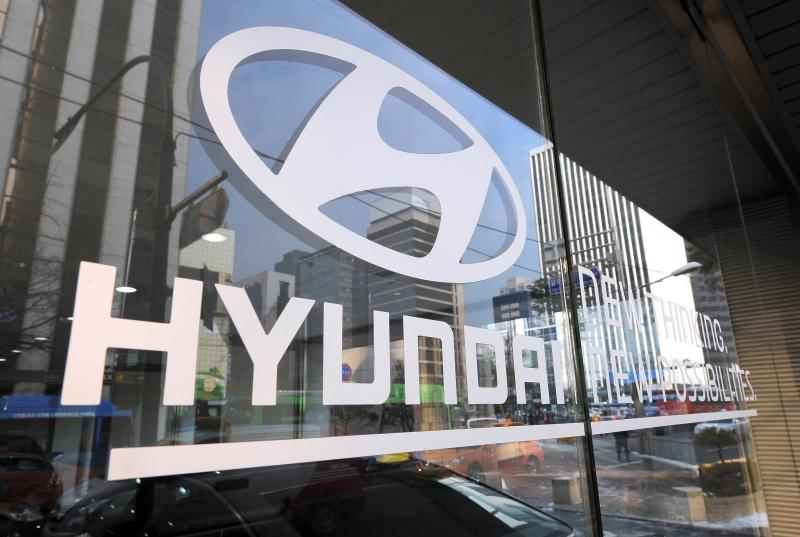 The logo of Hyundai Motor is seen on the glass door at its branch in Seoul on January 2014. Hyundai launched the new Sonata sedan in South Korea on Monday in the model\'s first makeover in nearly five years - AFP Photo.