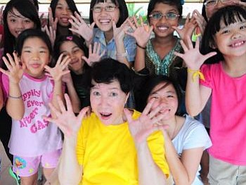 Her secret of youth: Kam Sun-Yoke credits HRT (hormone replacement therapy) and daily application of olive oil to her skin for her youthful looks but the one element that has kept this choir mistress on her toes is her work with the young.