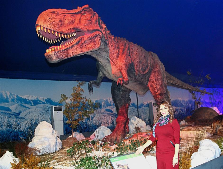 Royas (inset) standing next to a T-Rex, one of the biggest creatures at the Ice Age Alive exhibition.