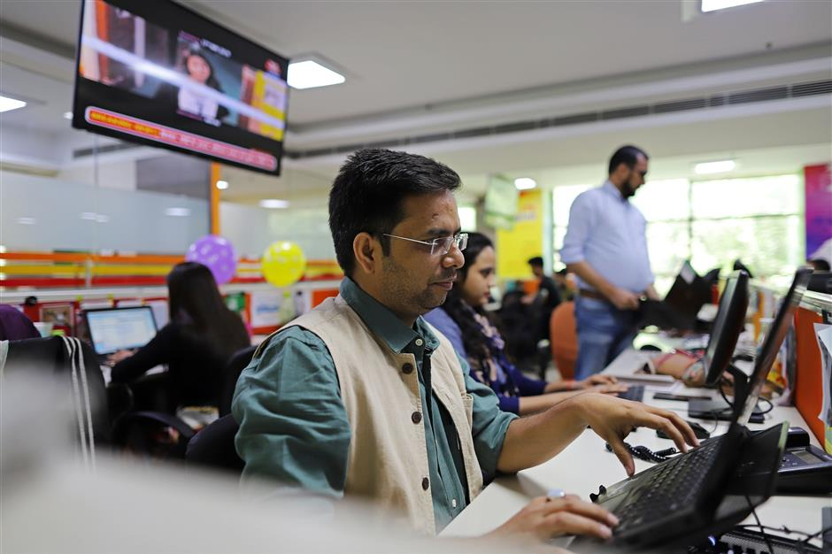 Employees work in the office of Vishwas News, operated by Jagran New Media, in New Delhi, India, on Friday, May 17, 2019. Facebook, Twitter Inc. and Google parent Alphabet Inc. are discovering the harsh reality that disinformation and hate speech are even more challenging in emerging markets than in places like the U.S. or Europe. Vishvas, Facebook's largest Indian-language fact-checking contractor, faces the challenge of working in country with 23 official languages. Photographer: Anindito Mukherjee/Bloomberg