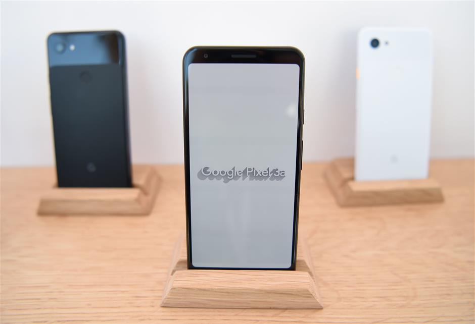 New Google Pixel 3a phones are displayed during the Google I/O conference at Shoreline Amphitheatre in Mountain View, California on May 7, 2019. (Photo by Josh Edelson / AFP)