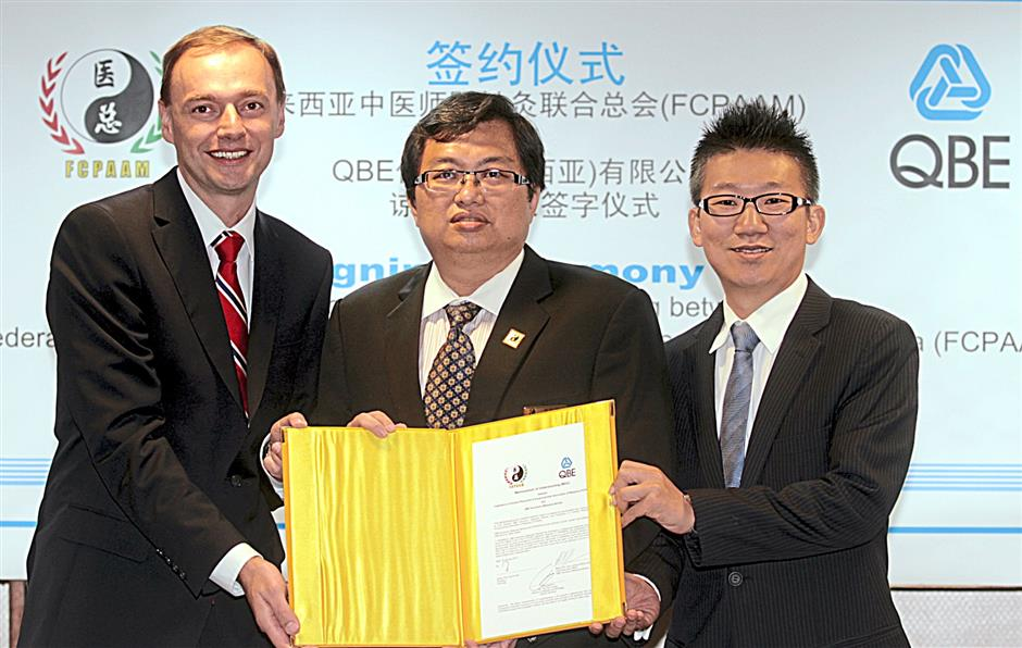 Australia's largest insurance company QBE has signed a MoU with the Federation of Chinese Physicians and Acupuncturists Association of Malaysia to insure 3,000 traditional Chinese medicine practitioners.From left Karl Hamann CEO QBE Insurance Bhd, Ng Po Kok President FCPAM and Yap Mum Loong Director Citylife Services.