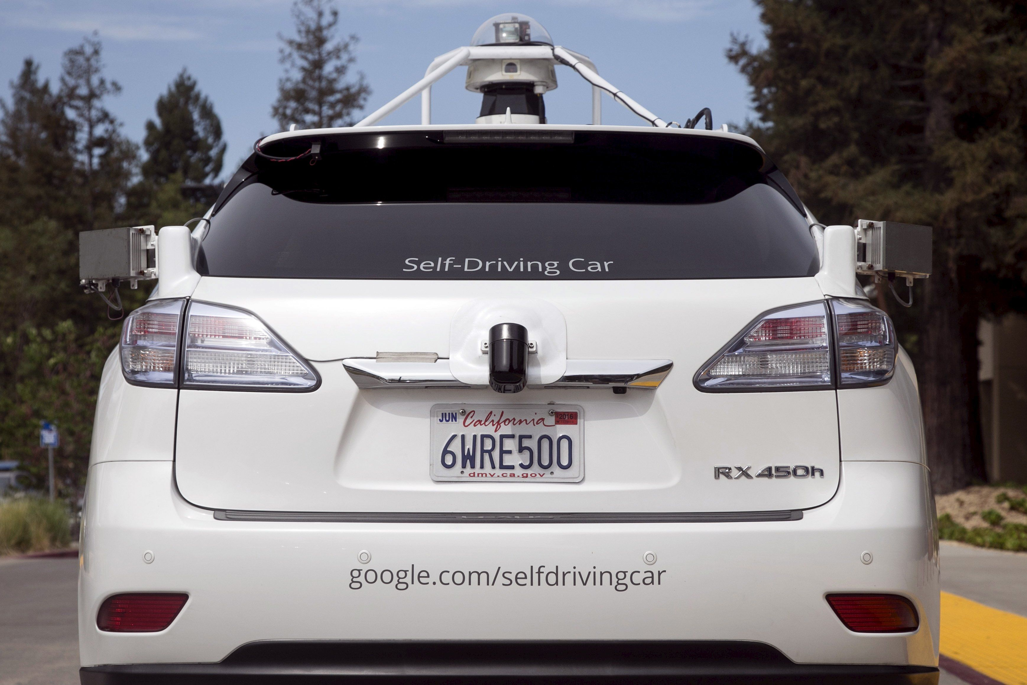 File photograph shows the rear of a Lexus SUV equipped with Google self-driving sensors during a media preview of Google's prototype autonomous vehicles in Mountain View, California September 29, 2015. Britain said on March 12, 2016  it will begin trialling driverless cars on motorways for the first time in 2017, as it moves towards its goal of allowing autonomous cars to take to the streets by 2020. Finance minister George Osborne will announce plans on Wednesday to test vehicles on motorways and say the government will bring forward proposals to remove regulatory barriers to the technology, the Treasury said. Alphabet Inc GOOGL.O unit Google wants to eventually be able to deploy fully autonomous vehicles without human controls, and major automakers are racing to develop vehicles that can drive themselves at least part of the time.  REUTERS/Elijah Nouvelage/Files