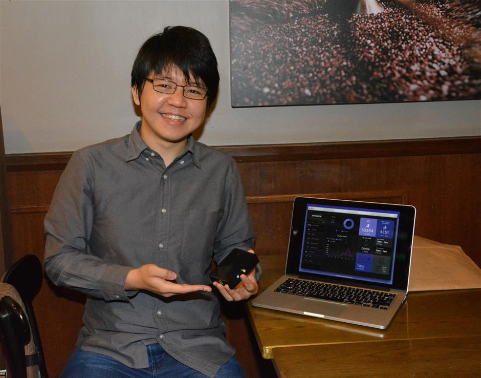 Simple setup: Ivan Loh Kah Lun, founder of Tide Analytics holds up a Rasperry Pi devices in his left hand. The device is used by his company to capture mobile phone IDs in order to perform market analysis that can help retailers make better marketing decisions. FOR BYTZ USE ONLY.