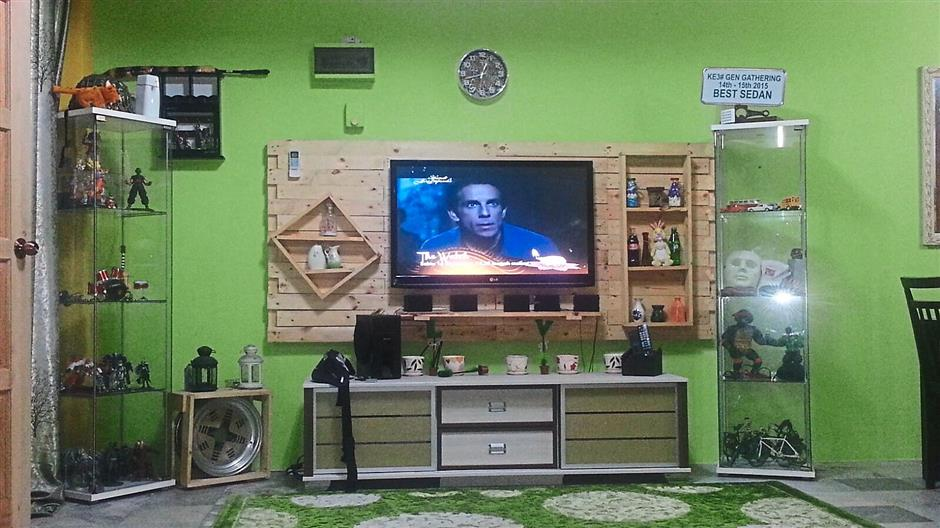 Marini Mohammad with her re purpose wood pallet made into television cabinets and shelves.