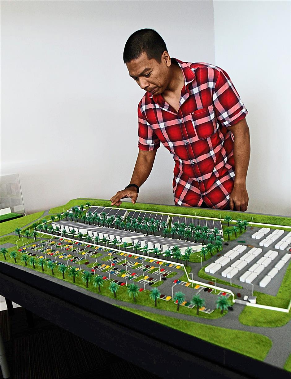 Razlan showing a model of part of the circuit. The complex sits on 300ha of land, of which only 30ha is used for the circuit.