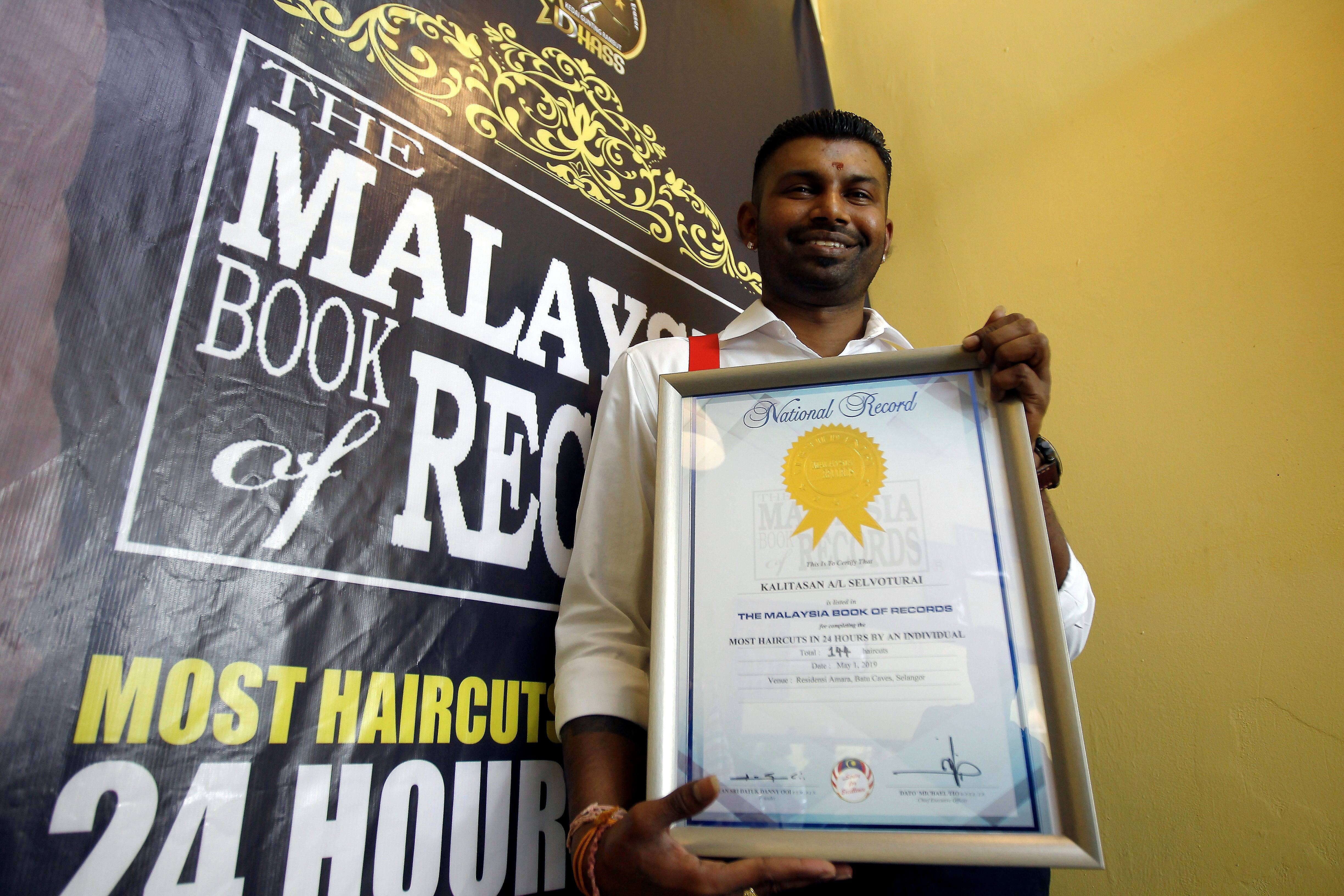 Barber Snips His Way Into Malaysia Book Of Records The Star