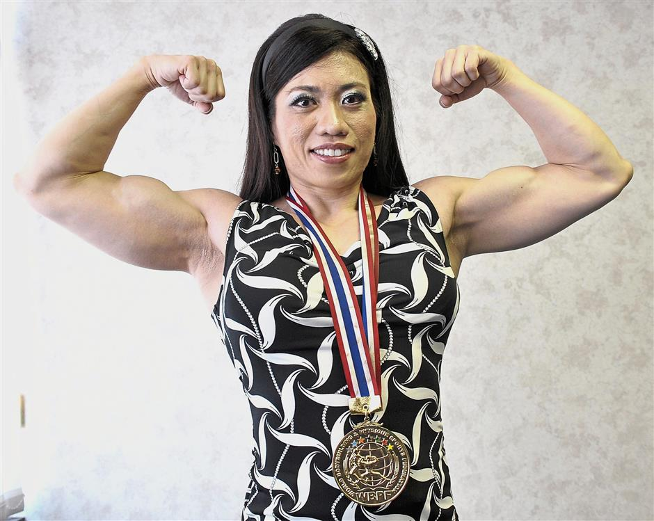 Lilian Tan striking a pose with her 2012 World Bodybuilding and Physique Federation (WBPF) World Championships gold medal.