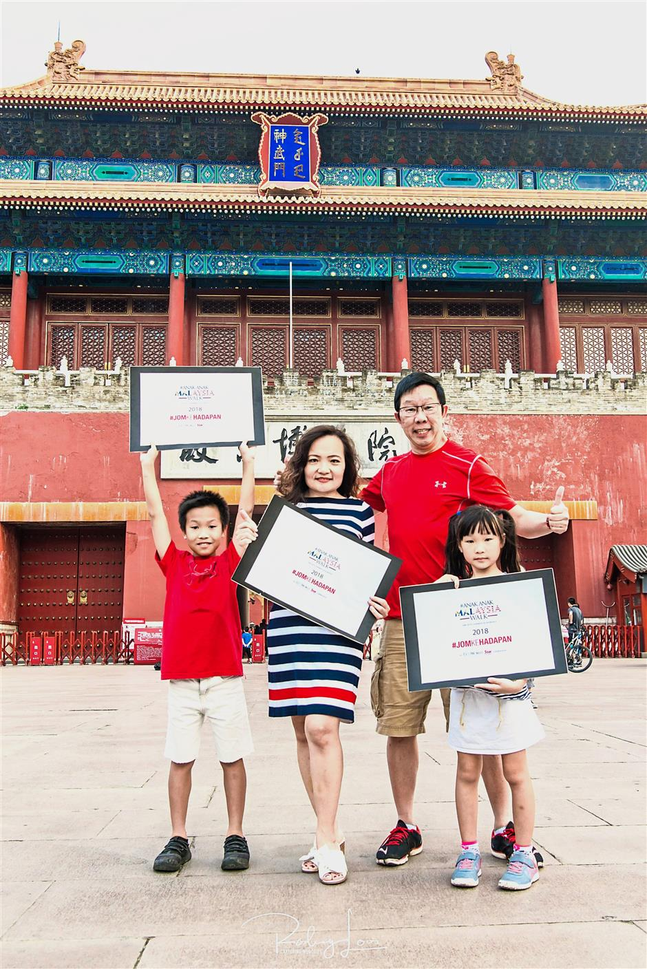 Family affair: Windows Category Management (Microsoft) director Catherine Goh, photographer Rodney Looi and their children Ryan and Chenya at the Forbidden City in Beijing.