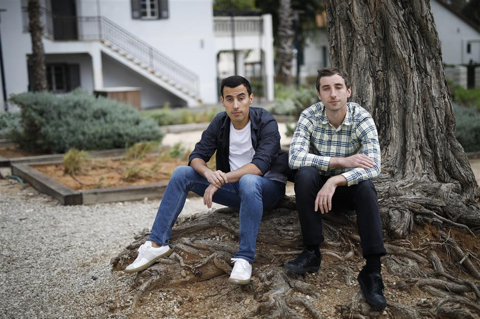 Igor, left, and Dmitri Bukhman, founders of Playrix Holding Ltd., pose for a photograph at Sarona Market in Tel Aviv, Israel, on Friday, March 29, 2019. The brothers are the brains behindu00a0Playrix Holding Ltd., the creator of popular games similar to Candy Crush, including Fishdom and Gardenscapes, with more than 30 million daily users from China to the U.S. and annual sales of $1.2 billion, according to Newzoo. Photographer: Corinnau00a0Kern/Bloomberg