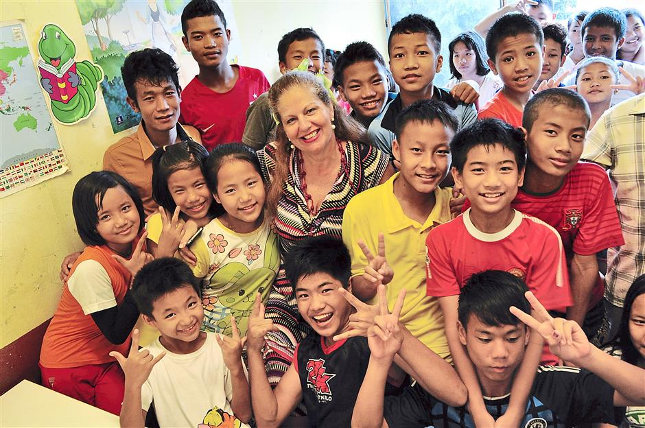 All smiles: Kortum with the children from the Chin Student Organisation where she volunteers.