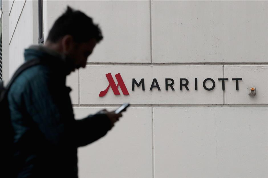 CHICAGO, IL - NOVEMBER 30: A sign marks the location of a Marriott hotel on November 30, 2018 in Chicago, Illinois. Marriott says their Starwood guest reservation database was hacked, compromising the security of private information for up to 500 million hotel customers.   Scott Olson/Getty Images/AFP == FOR NEWSPAPERS, INTERNET, TELCOS & TELEVISION USE ONLY ==