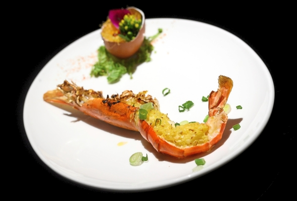 The revamped a la carte menu features main dishes like Blue River Prawn with Garlic Butter Sauce.