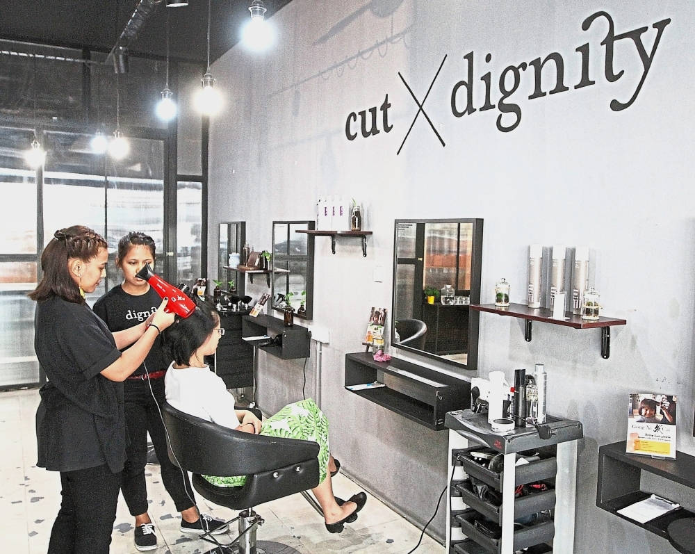 Fatimah (left) and Priska plan to run their own business someday with the hair-styling skills they acquired at Cut X Dignity.