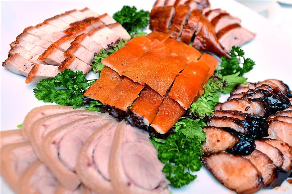For meat lovers: Five Happiness Assorted BBQ meat dish which comprises thinly sliced poached pork, roasted duck and pork, suckling pig and BBQ pork.