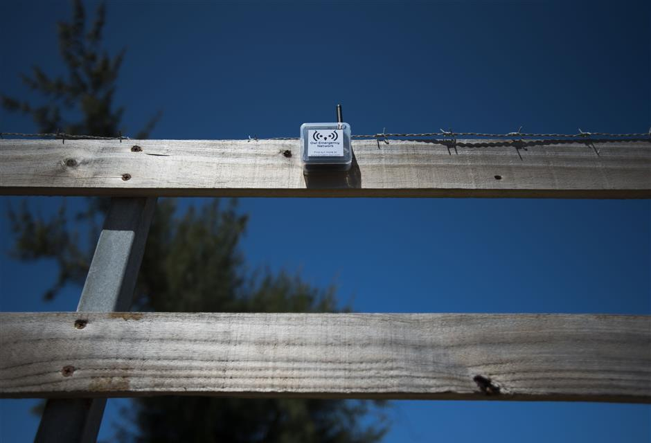 This March 13, 2019 photo shows a transmitter that is part of a system that provides a low-frequency Wi-Fi connection, affixed to the slat of a wooden fence, during a field test in Isabela, Puerto Rico. The transmitters are powered by batteries and maybe eventually solar power. (AP Photo/Carlos Giusti)