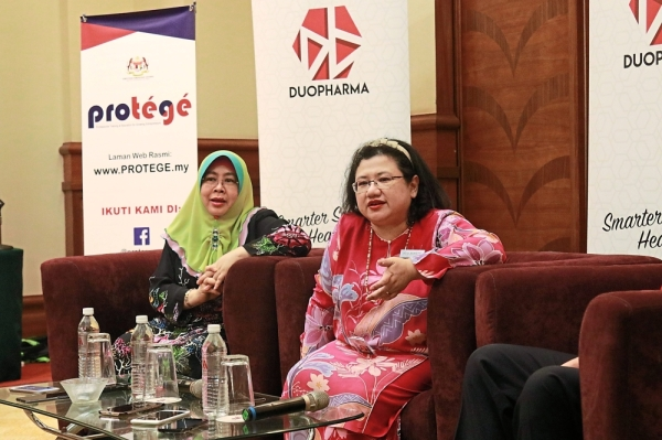 Providing answers: Wan Suraya (right) answering a question at the closing ceremony on March 21 as PROTu00c9Gu00c9 head of secretariat Norashikin Ismail looks on.