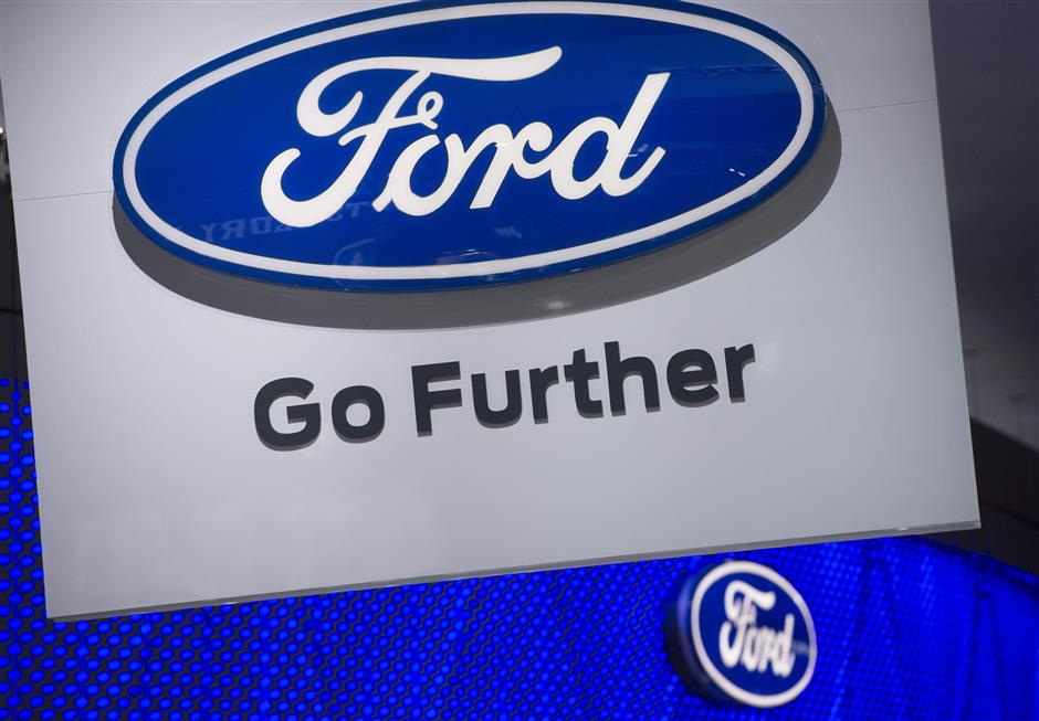 (FILES) In this file photo taken on January 10, 2017 showing the Ford logo during the 2017 North American International Auto Show in Detroit, Michigan. On June 19, 2018, Bill Ford Jr., the great-grandson of the American carmaker\'s founder, stood in front of thousands Tuesday in Detroit, with an abandoned train station in the background, and entwined the company\'s future with that of the dilapidated building behind him.  / AFP PHOTO / SAUL LOEB