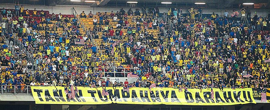 Malaysian fans during their AFF Suzuki Cup 2010 semi-final match at the Bukit Jalil Stadium, December 15, 2010. GLENN GUAN/The Star