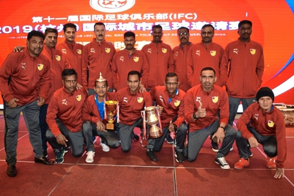 The IRC squad with top scorer Nanthakumar (standing, left) celebrating their win.