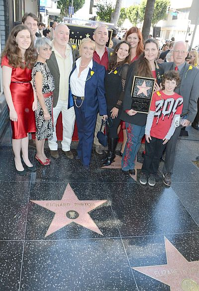 Family and friends of actor Richard Burton including his daughter Maria Burton (holding placard at right) attend the ceremony honoring the late actor with a star on the Hollywood Walk of Fame next to Elizabeth Taylor\'s star on March 1, 2013 in Hollywood, California. - AFP PHOTO/Robyn BECK