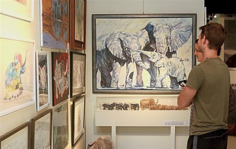 Visitors admiring the artworks picked for the Art On Wildlife Conservation International Art Exchange.
