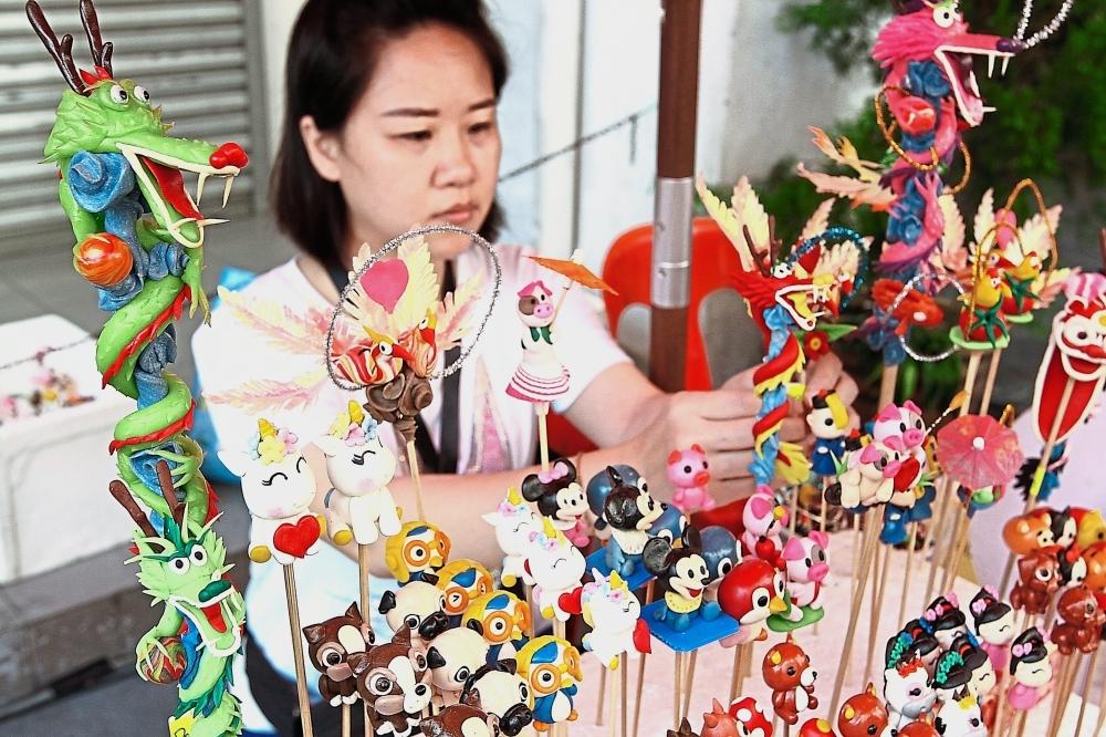 Karmen Chan selling dough dolls she designed herself at the festival.