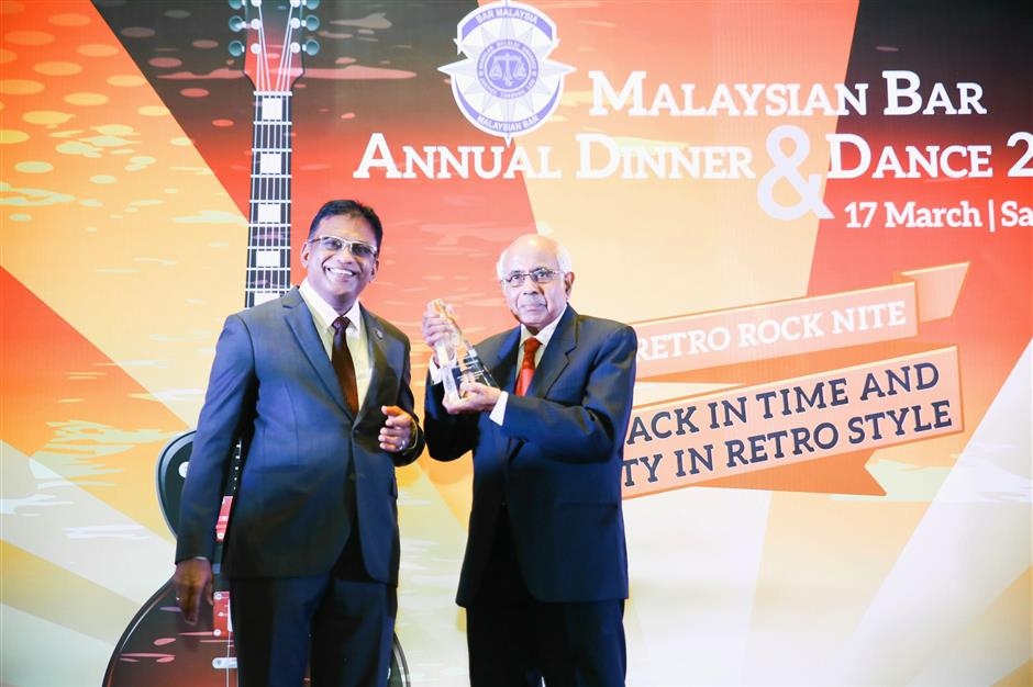 Great honour: Param (right) receiving the Malaysian Baru2019s Lifetime Achievement Award from current president George Varughese. u2013Courtesy of the Bar Council